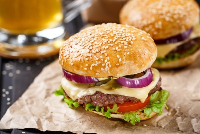 Delicious burger with beef, cheese and vegetables